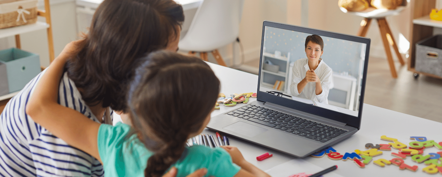 Mom and child in online therapy via laptop - Decorative - When Does My Child Need Speech Therapy Article